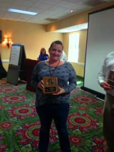 Woman holding certification in hand